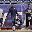 New England Patriots kicker Stephen Gostkowski, left, defensive end Zach Moore (90) and wide receiver Danny Amendola, right, walk onto the field for a walk-through at the NFL football team's facility Tuesday, Oct. 14, 2014 in Foxborough, Mass. The Patrio