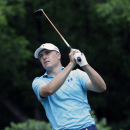 Jordan Spieth watches his tee shot on the second hole during the first round of the Colonial golf tournament, Thursday, May 21, 2015, in Fort Worth, Texas. (AP Photo/LM Otero)