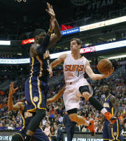 Phoenix Suns shooting guard Goran Dragic (1) tries to pass around Indiana Pacers center Roy Hibbert (55) during the first half of their NBA game, Wednesday, Jan. 22, 2014 in Phoenix. (AP Photo/The Arizona Republic, David Kadlubowski)
