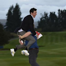Team Europe golfer Rory McIlroy is lifted up by a colleague after the closing ceremony of the 40th Ryder Cup at Gleneagles in Scotland September 28, 2014. Captain Paul McGinley described each of his players as
