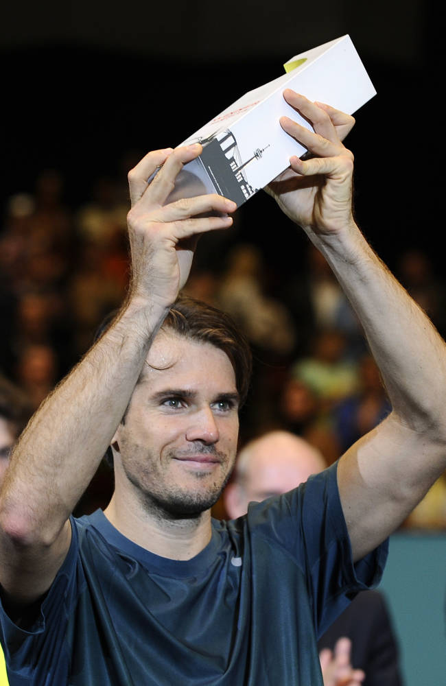 Tommy Haas of Germany holds the trophy after winning the final match against Robin Haase of the Netherlands at the Erste Bank Open tennis tournament in Vienna, Austria, Sunday, Oct. 20, 2013