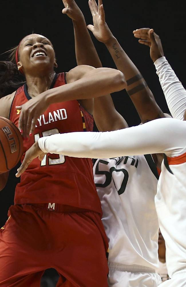 Miami's Maria Brown (50) and Necole Sterling (15) block Maryland's Alicia DeVaughn (13) during the second half of an NCAA college basketball game in Coral Gables, Fla., Thursday, Feb. 13, 2014. Maryland won 67-52