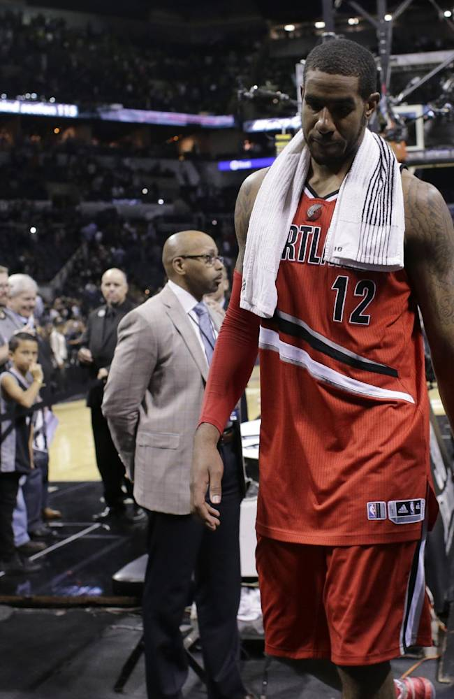 Portland Trail Blazers' LaMarcus Aldridge walks off the court following the team's loss in Game 5 of a Western Conference semifinal NBA basketball playoff series, Wednesday, May 14, 2014, in San Antonio. San Antonio won 104-82