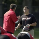 Tampa Bay Buccaneers head coach Greg Schiano, right, talks to special teams coordinator Dave Wannstedt during an optional NFL football team workout Monday, May 20, 2013, in Tampa, Fla. (AP Photo/Chris O'Meara)