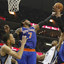 New York Knicks forward Carmelo Anthony (7), center Tyson Chandler, right, and guard Raymond Felton (2) contest a rebound against Memphis Grizzlies forward Courtney Lee (5) and Tayshaun Prince in the second half of an NBA basketball game Tuesday, Feb. 18,