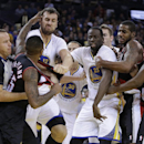Portland Trail Blazers' Mo Williams, left, is restrained by a referee as he fights with Golden State Warriors' Andrew Bogut (12) during the second half of an NBA basketball game Saturday, Nov. 23, 2013, in Oakland, Calif. Trail Blazers Wesley Matthews (2)