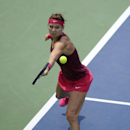 Lucie Safarova, of The Czech Republic, reaches for the ball against Kristina Mladenovic, of France, during a match at the Citi Open tennis tournament, Tuesday, July 29, 2014, in Washington. (AP Photo/Nick Wass)