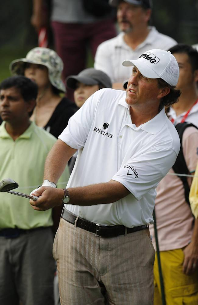 U.S. Phil Mickelson watches his shot on the 11th hole during the second round of the CIMB Classic golf tournament at the Kuala Lumpur Golf and Country Club in Kuala Lumpur, Malaysia, Friday, Oct. 25, 2013