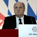 FILE - In this Nov. 18, 2011 file photo Uli Hoeness, President of German first division Bundesliga team FC Bayern Munich, looks on prior to his speech at the annual general meeting of FC Bayern Munich soccer club in Munich, southern Germany. German prosecutors have charged Bayern Munich President Uli Hoeness with tax evasion. Munich prosecutors' spokesman Ken Heidenreich said Tuesday, July 30, 2013, that Hoeness' lawyers have one month to respond to the charges, and a Munich court will decide whether the case goes to trial. He wouldn't say how long that decision might take. (AP Photo/Matthias Schrader, File)
