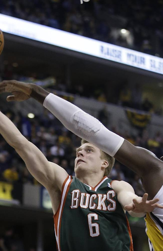 Milwaukee Bucks' Nate Wolters (6) shoots against Indiana Pacers' Roy Hibbert (55) during the first half of an NBA basketball game on Thursday, Feb. 27, 2014, in Indianapolis