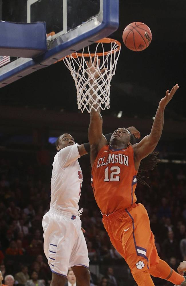 Clemson's Rod Hall (12) drives to the basket during the second half of an NCAA college basketball game against SMU in the semifinals of the NIT Tuesday, April 1, 2014, in New York. SMU won the game 65-59