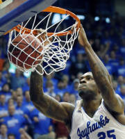 Kansas forward Tarik Black (25) dunks during the first half of an NCAA college basketball game against Oklahoma State at Allen Fieldhouse in Lawrence, Kan., Saturday, Jan. 18, 2014. Kansas defeated Oklahoma State 80-78. (AP Photo/Orlin Wagner)