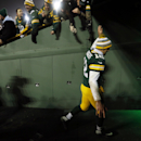 Green Bay Packers' Aaron Rodgers celebrates with fans on his way to the locker room after an NFL football game against the Atlanta Falcons Monday, Dec. 8, 2014, in Green Bay, Wis. The Packers won 43-37 The Associated Press