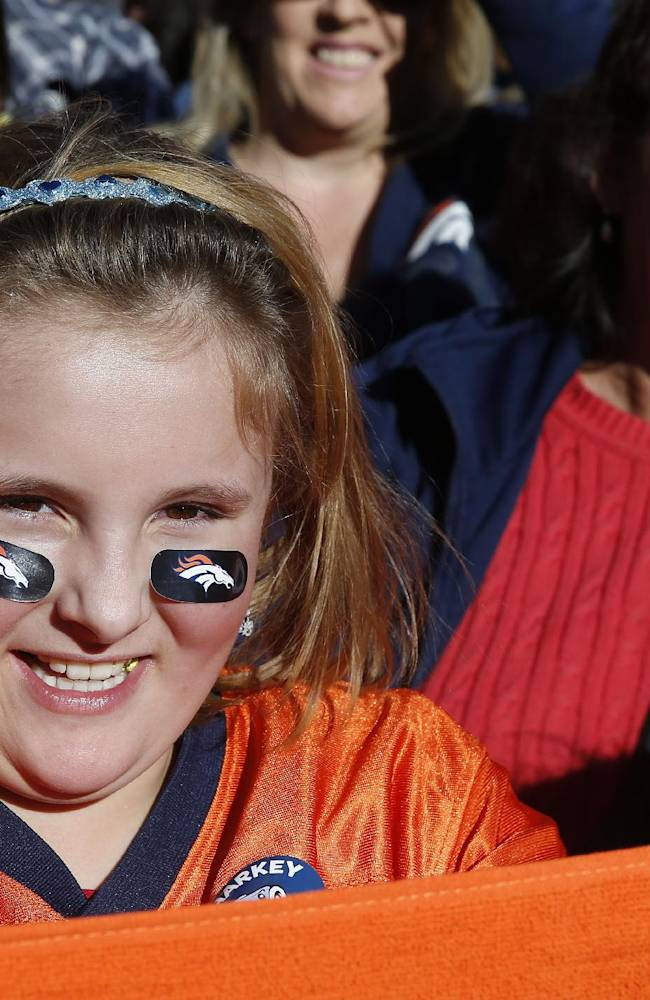 Denver Broncos fans cheer at a Broncos rally in downtown in Denver, Friday, Jan. 17, 2014. The Broncos are scheduled to host the New England Patriots on Sunday for the AFC championship
