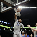 Brooklyn Nets' Paul Pierce (34) dunks in front of New York Knicks' Amare Stoudemire (1) during the first half of an NBA basketball game Tuesday, April 15, 2014, in New York The Associated Press
