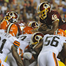 Washington Redskins running back Alfred Morris (46) attempts to dive over the pile but does not reach the goal line as he stopped by Cleveland Browns strong safety Donte Whitner (31) and inside linebacker Karlos Dansby (56) and others, during the first ha