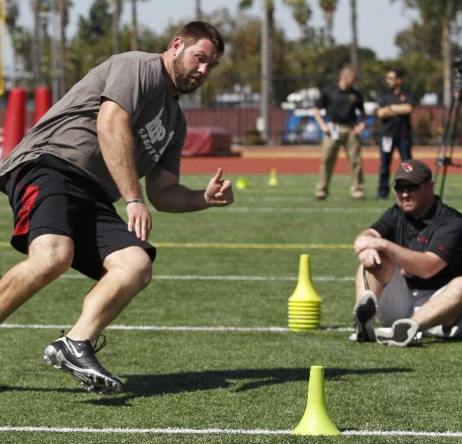 Offensive lineman Kevin Graf works out during Southern California pro day for NFL scouts at Loker Field on Wednesday, March 12, 2014, in Los Angeles
