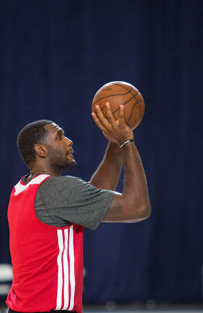 Miami Heat center Greg Oden aims for a free throw at the Atlantis resort on Paradise Island, Bahamas, Wednesday, Oct. 2, 2013. The two-time defending NBA champions are holding a one week training camp at the resort