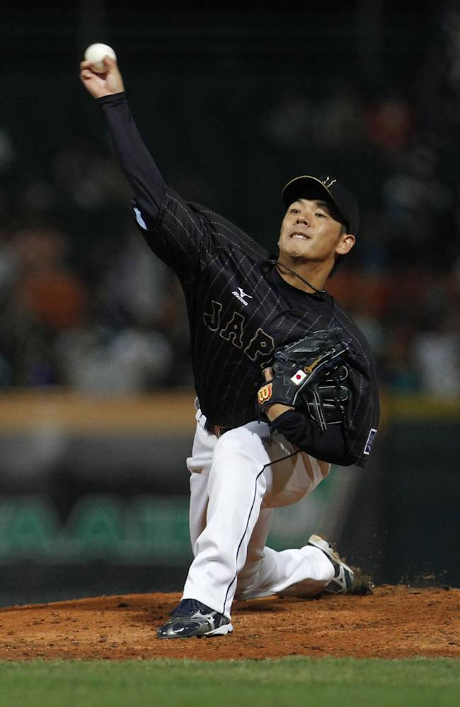 Team Japan starter Yasuhiro Ogawa pitches against Taiwan in the first inning of their exhibition baseball game at the Xinzhuang Baseball Stadium in New Taipei City, Taiwan, Friday, Nov. 8, 2013