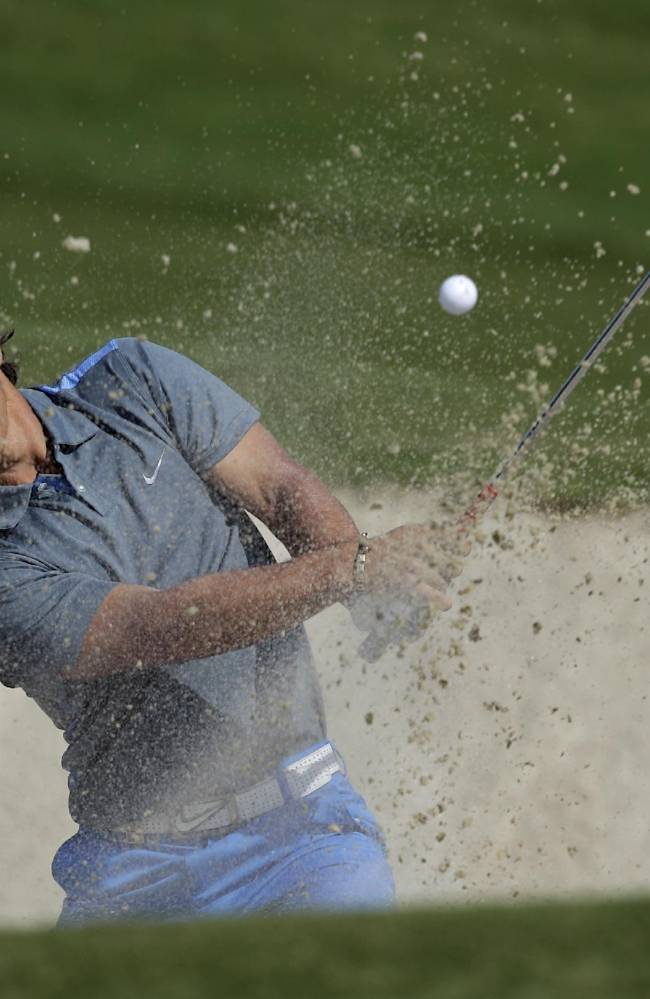 Denmark's Thorbjorn Olesen plays a bunker shot on the 2nd hole during the 2nd round of DP World Golf Championship in Dubai, United Arab Emirates, Friday Nov. 15, 2013