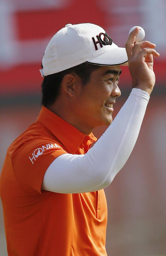 Liang Wenchong of China celebrates after making a birdie putt on the 18th green during the second round of the HSBC Champions golf tournament at the Sheshan International Golf Club in Shanghai, China, Friday, Nov. 1, 2013