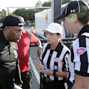 In a photo provided by the NFL, Houston coach Brian Wiggins listens as referee Shannon Eastin, center, and official Catherine Conti give pre-game instructions at the International Women's Football League Championships, Saturday, July 26, 2014. in Rock Hil