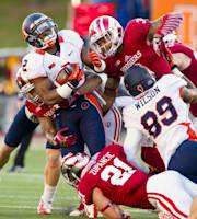 Illinois' V'Angelo Bentley (2) is brought down by the Indiana defense during the first half of an NCAA college football game, Saturday, Nov. 9, 2013, in Bloomington, Ind. (AP Photo/Doug McSchooler)