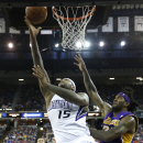 Sacramento Kings center DeMarcus Cousins, left, goes to the basket against Los Angeles Lakers center Jordan Hill during the third quarter of an NBA basketball game Wednesday, April 2, 2014, in Sacramento, Calif. The Kings won 107-102 The Associated Press
