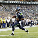 Seattle Seahawks quarterback Russell Wilson rushes for a touchdown against the San Diego Chargers in the first half of a preseason NFL football game, Friday, Aug. 15, 2014, in Seattle The Associated Press