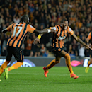 Hull City's Abel Hernandez, right, celebrates with teammate Mohamed Diame after scoring against West Ham United during the English Premier League soccer match at the KC Stadium, Hull, England, Monday Sept. 15, 2014