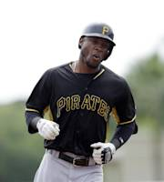 Pittsburgh Pirates' Starling Marte rounds third base after his solo home run during the first inning of a spring exhibition baseball game against the Baltimore Orioles in Sarasota, Fla., Sunday, March 23, 2014. (AP Photo/Carlos Osorio)