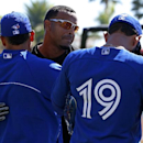 Baltimore Orioles' Nelson Cruz, center, visits with Toronto Blue Jays' Melky Cabrera, left, and Jose Bautista (19) before an exhibition spring training baseball game in Sarasota, Fla., Saturday, March 1, 2014 The Associated Press