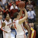 Ohio State guard Aaron Craft (4) shoots the game-winning basket against Iowa State in a third-round game of the NCAA college basketball tournament on Sunday, March 24, 2013, in Dayton, Ohio. Ohio State won 7-75. (AP Photo/Al Behrman)