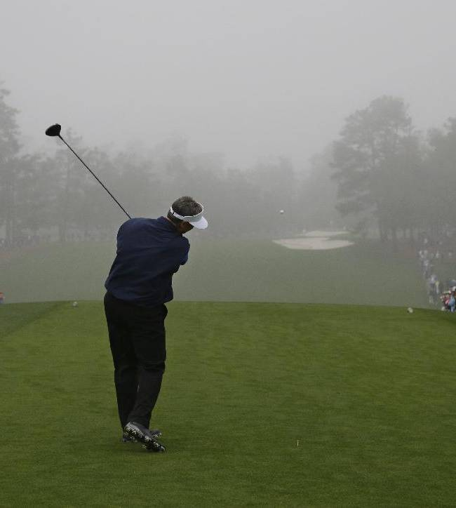 Amateur Michael McCoy tees off into the mist during a practice session for the Masters golf tournament Monday, April 7, 2014, in Augusta, Ga