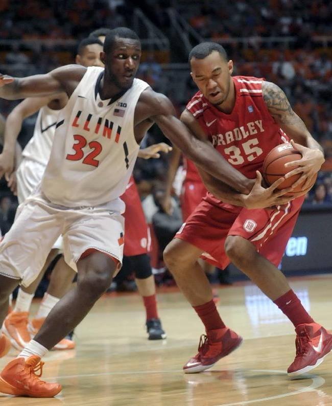Illinois' Nnanna Egwu (32) reaches for the ball controlled by Bradley forward Chris Blake (35) in the second half of an NCAA college basketball game Sunday, Nov. 17, 2013, in Champaign, Ill