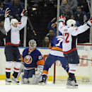 New York Islanders goalie Evgeni Nabokov (20) watches Washington Capitals' Jason Chimera (25) and Joel Ward (42) celebrate Ward's goal in the second period of an NHL hockey game on Saturday, April 5, 2014, in Uniondale, N.Y. The Capitals won 4-3 in a shoo