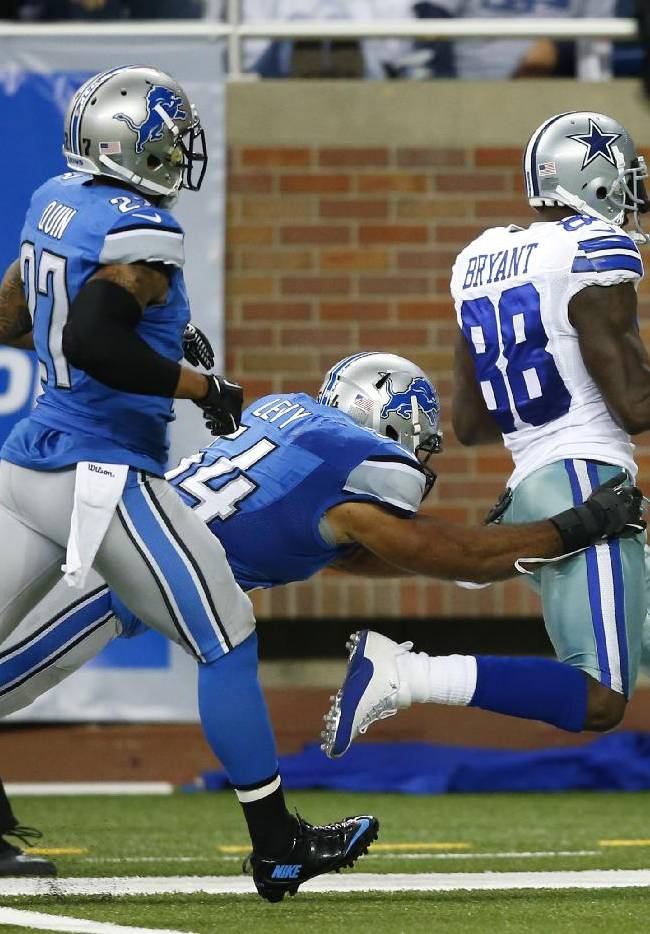 Dallas Cowboys wide receiver Dez Bryant (88) scores on a 50-yard touchdown reception as Detroit Lions outside linebacker DeAndre Levy (54) defends in the fourth quarter of an NFL football game in Detroit, Sunday, Oct. 27, 2013