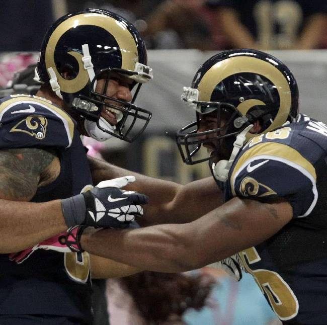 St. Louis Rams tight end Lance Kendricks, left, is congratulated by Cory Harkey after catching a 16-yard pass for a touchdown during the second quarter of an NFL football game against the Jacksonville Jaguars Sunday, Oct. 6, 2013, in St. Louis