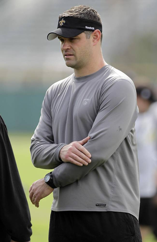 In this Feb. 5, 2010, file photo, New Orleans Saints quarterbacks coach Joe Lombardi watches during NFL football practice in Miami. A person familiar with the situation says new Detroit Lions head coach Jim Caldwell and Lombardi, the grandson of former Green Bay Packers Hall of Fame coach Vince Lombardi, have agreed on deal for Lombardi to become the Lions' offensive coordinator. The person spoke to The Associated Press on condition of anonymity on Tuesday, Jan. 21, 2014, because the Lions have not announced the hiring, which was first reported by ESPN