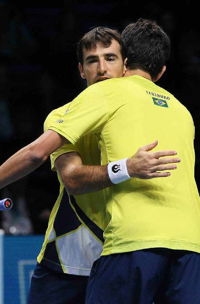 Ivan Dodig of Croatia, left, and Marcelo Melo of Brazil celebrate at match point after defeating Aisam-Ul-Haq Qureshi of Pakistan and Jean-Julien Rojer of the Netherlands in their ATP World Tour Finals tennis match at the O2 Arena on London, Saturday, Nov. 9, 2013