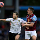 Aston Villa's Ciaran Clark and AFC Bournemouth's Harry Arter, left, battle for the ball, during the English FA Cup fourth round soccer match at Villa Park, Birmingham, England, Sunday Jan. 25, 2015