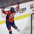 Washington Capitals' Troy Brouwer (20) celebrates his goal during the third period of an NHL hockey game against the Phoenix Coyotes, Saturday, March 8, 2014, in Washington. The Capitals won 3-2 The Associated Press