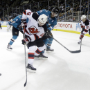 New Jersey Devils' Jacob Josefson (16) battles against San Jose Sharks center Patrick Marleau (12) during the second period of an NHL hockey game Monday, Jan. 19, 2015, in San Jose, Calif The Associated Press