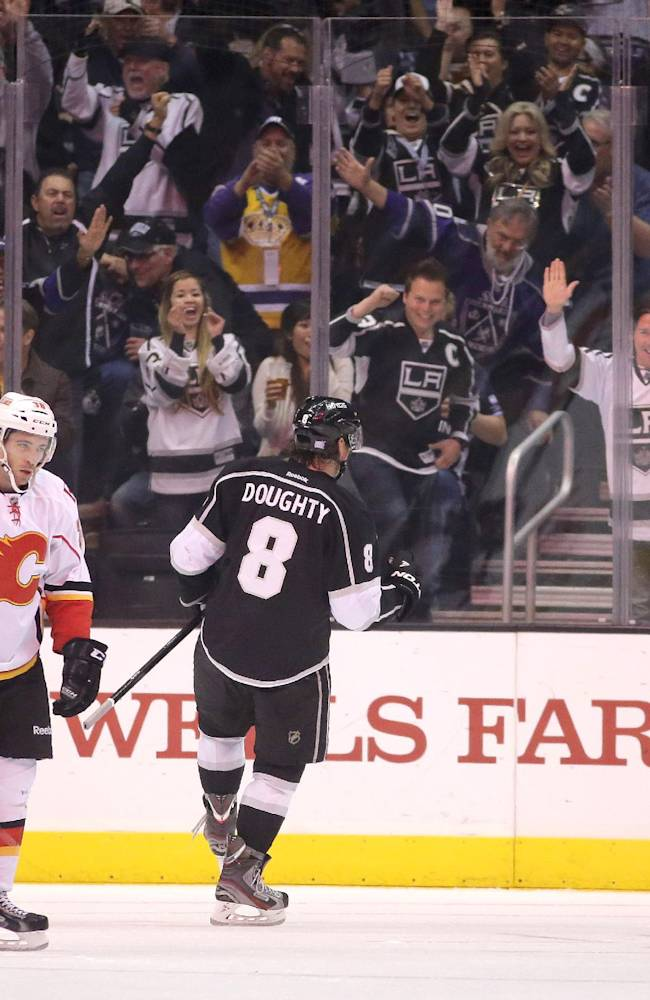 Los Angeles Kings defenseman Drew Doughty, right, celebrates his goal as Calgary Flames right wing Ben Street looks off during the first period of an NHL hockey game in  Los Angeles, Monday, Oct. 21, 2013