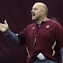 Boston College head coach Steve Addazio gestures to his players during a football practice in Boston, Tuesday, Dec. 16, 2014. Boston College will face Penn State in the Pinstripe Bowl on Dec. 27th at Yankee Stadium. (AP Photo/Charles Krupa)