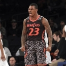 Cincinnati's Sean Kilpatrick reacts after making a basket during the first half of an NCAA college basketball game against Providence at the Big East Conference tournament, Wednesday, March 13, 2013 in New York. (AP Photo/Mary Altaffer)