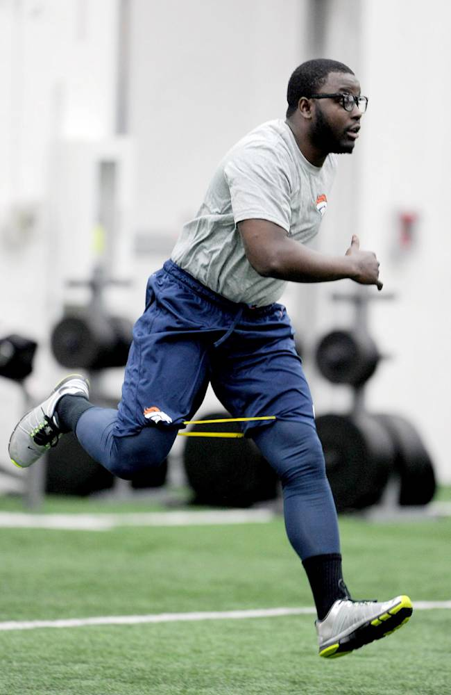 This photo provided by the Denver Broncos shows running back Monte Ball working out during an offseason training session at the NFL football teams training facility in Englewood, Colo., on Monday, April 21, 2014