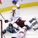 San Jose Sharks' Tomas Hertl, bottom, of the Czech Republic, collides with Arizona Coyotes' Lucas Lessio during the second period of an NHL preseason hockey game Friday, Sept. 26, 2014, in San Jose, Calif. The Associated Press