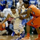 Duke's Quinn Cook, left, dribbles the ball as Clemson's Adonis Filer (3) defends during the first half of an NCAA college basketball game in Durham, N.C., Tuesday, Jan. 8, 2013. (AP Photo/Gerry Broome)