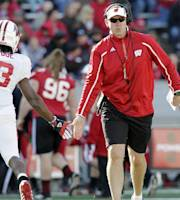 FILE - In this April 20, 2013, file photo, Wisconsin head coach Gary Andersen, right, encourages wide receiver Kenzel Doe (3) during their spring NCAA college football game at Camp Randall Stadium in Madison, Wis. Andersen is soft-spoken but tough. He doesn't like meetings. And he's bringing a new vibe to Wisconsin. But the goals don't change for the 23rd-ranked Badgers, as evidenced by the sign in the players tunnel that reads